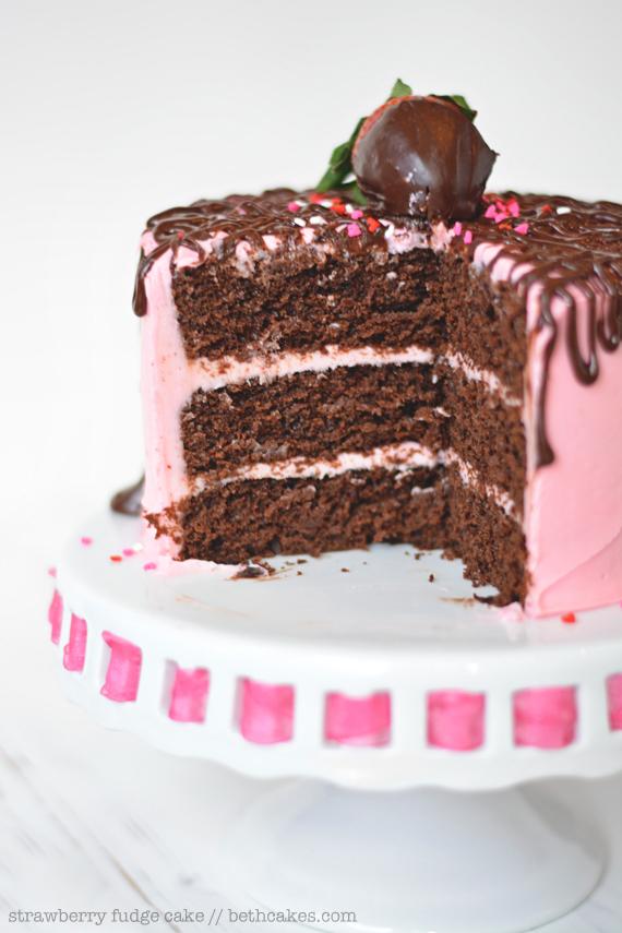 Strawberry Fudge Cake: rich chocolate cake, creamy strawberry frosting, and lots of chocolate ganache. bethcakes.com #valentinesday