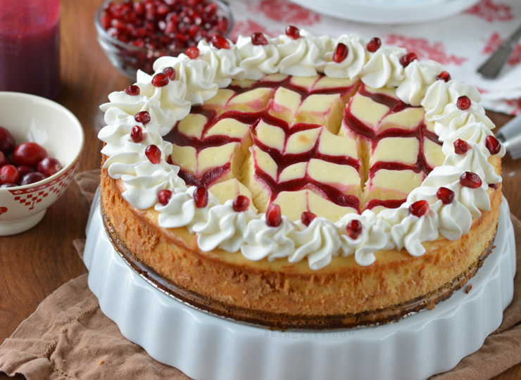 Cranberry-Pomegranate Swirled White Chocolate Cheesecake