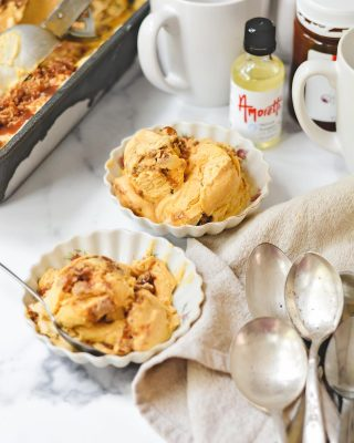 """We're having fall ice cream today, friends! #ad If you're like me and you're a year-round ice cream person, you will LOVE this No-Churn Pumpkin Pie Ice Cream! It's made with Natural Pumpkin Pie Extract and Caramel Sauce from @Amoretti! #Amoretti is known for their high quality products, most of which are all-natural and preservative-free, that are used in restaurants and bakeries all over the world! This ice cream is flavored with pumpkin purée and plenty of spices, plus has layers of homemade crumbles and Amoretti's Caramel Dessert Sauce! Did I mention this is no-churn too?? So easy and fun for a cozy autumn night! Grab the recipe below! #amorettifallbaking   HOMEMADE CRUMBLES: ⅓ cup all-purpose flour ¼ cup old fashioned oats 2 Tbsp sugar 2 Tbsp brown sugar ¼ tsp ground cinnamon 4 Tbsp cold butter, grated   Preheat oven to 350°F and line a sheet pan with parchment paper. In a medium bowl, whisk together flour, oats, sugar, brown sugar, and cinnamon. Add grated butter and use your hands to mix the butter into the dry ingredients until the mixture holds its shape and dry ingredients are incorporated. Spread crumbles on the prepared sheet pan and bake 8-10 minutes. Remove from oven and cool completely.   NO-CHURN PUMPKIN PIE ICE CREAM: 1 (14-oz) can sweetened condensed milk ¾ cup pumpkin purée 1 tsp Amoretti Natural Pumpkin Extract 1 tsp pumpkin pie spice 2 cups heavy cream 1 (8-oz) container Amoretti Caramel Dessert Sauce   To make the ice cream, whisk together sweetened condensed milk, pumpkin purée, Amoretti Natural Pumpkin Extract, and pumpkin pie spice. In the bowl of a stand mixer with the whisk attachment, whip heavy cream on high speed until stiff peaks form. Add half of whipped cream to the pumpkin mixture; fold until incorporated. Repeat with second half of whipped cream. In a 9""""x5"""" loaf pan, add half of the ice cream and sprinkle with half of the crumbles. Next, drizzle a layer of caramel sauce. Spoon the remaining ice cream over the caramel and repeat with"""