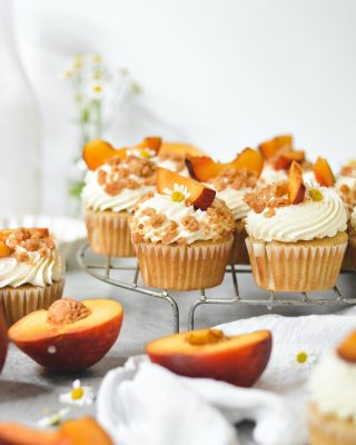 The best way to ring in the summer season? These Peach Pie Cupcakes! #ad With a lightly spiced cake, a peach filling, peach frosting, homemade crumbles, and freshly sliced peaches, these cupcakes are easy to whip up thanks to Crisco®! #Crisco helps make the cake soft and moist and the frosting light and fluffy. With crumb topping and lots of peach flavor, these cupcakes incorporate everything good and delicious that makes up a classic and summery peach pie. #Crisco has been a staple in my pantry for years, and I love that I know my cakes will turn out wonderfully and delicious every single time. Grab the recipe for these Peach Pie Cupcakes at the link in my bio and celebrate summer! #cookwithscrisco #cookingwithcrisco       https://www.bethcakes.com/peach-pie-cupcakes