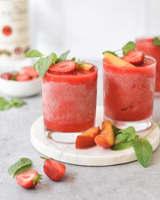 strawberry peach daiquiris! 🍓🍑🍹 it's friday eve and these babies are new on the blog today! picked up some fresh peaches when i went strawberry picking a couple of weekends ago and daiquiris had to happen. they're super easy and customizable. also nice and frosty. recipe link in bio, friends!         https://bethcakes.com/strawberry-peach-daiquiris/