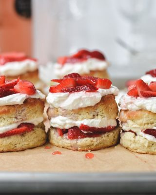 strawberry rosé shortcakes for your weekend! soak your berries in your fave rosé and pile them high with fluffy whipped cream and these super easy greek yogurt biscuits 🍓🍓        https://bethcakes.com/strawberry-rose-shortcakes/