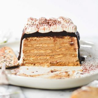 this icebox opera cake is new on the blog today because it's july in alabama and sometimes we want to be chill and fancy at the same time. 😜 in true icebox cake fashion, graham crackers are layered up with a creamy custard. in opera cake fashion, the grahams get a dip in coffee syrup and the custard is espresso flavored & topped with ganache. it lives in your freezer and you can sneak a bite whenever you need to cool down! recipe link in bio, friends! . . https://bethcakes.com/icebox-opera-cake/ . . #f52grams #buzzfeedfood #huffposttaste #thekitchn #slbakes #feedfeed #feedfeedbaking #amblifeissweet #BHGfood #bhgbaking #bhgcelebrate #bareaders #f52community #foodandwine #thebakefeed #madewithkitchenaid @williamssonoma  #saveurmag #wsbakeclub #ABMfoodie #mysouthernliving #foodblogfeed #lifeandthyme #makemore #recipeoftheday #bethcakes #summervibes #foodtographyschool #howisummer