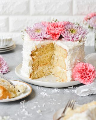 Today on the blog I'm excited to share this Coconut Dream Cake for so many reasons! #ad It's one of my grandmother's old fashioned recipes with a sweet and creamy coconut sour cream filling between the layers. I've updated the recipe little bit, and it uses some of my favorite baking ingredients, #ClabberGirl baking powder and Crisco shortening and oil! Quality cakes start with quality ingredients, and @clabbergirlbaking is the number one baking powder in America! These ingredients help create a super soft and light cake, plus the fluffiest coconut buttercream. With a layer of shredded coconut all over and fresh flowers on top, this cake is perfect to share with your family for Easter! You can find the recipe on my blog and linked in my bio! #sponsored