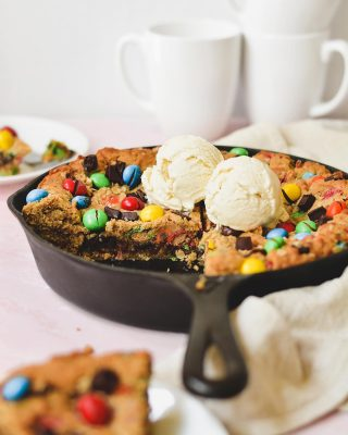 skillet monster cookie is new on the blog today, y'all! it's loaded with peanut butter, oats, m&m's, and chocolate chips and has the BEST texture 😍🤤 dense soft gooey cookie insides yes pls ty goodnight! 🙌 recipe link in bio!       https://bethcakes.com/skillet-monster-cookie/